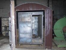 Реторты внутри пиролизной печи для производства древесного угля